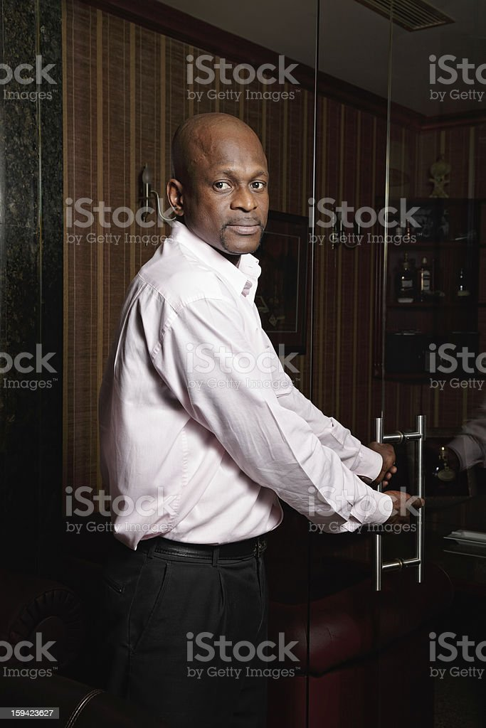African man welcomes to his office royalty-free stock photo
