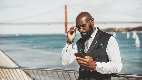 African man with cellphone outdoors