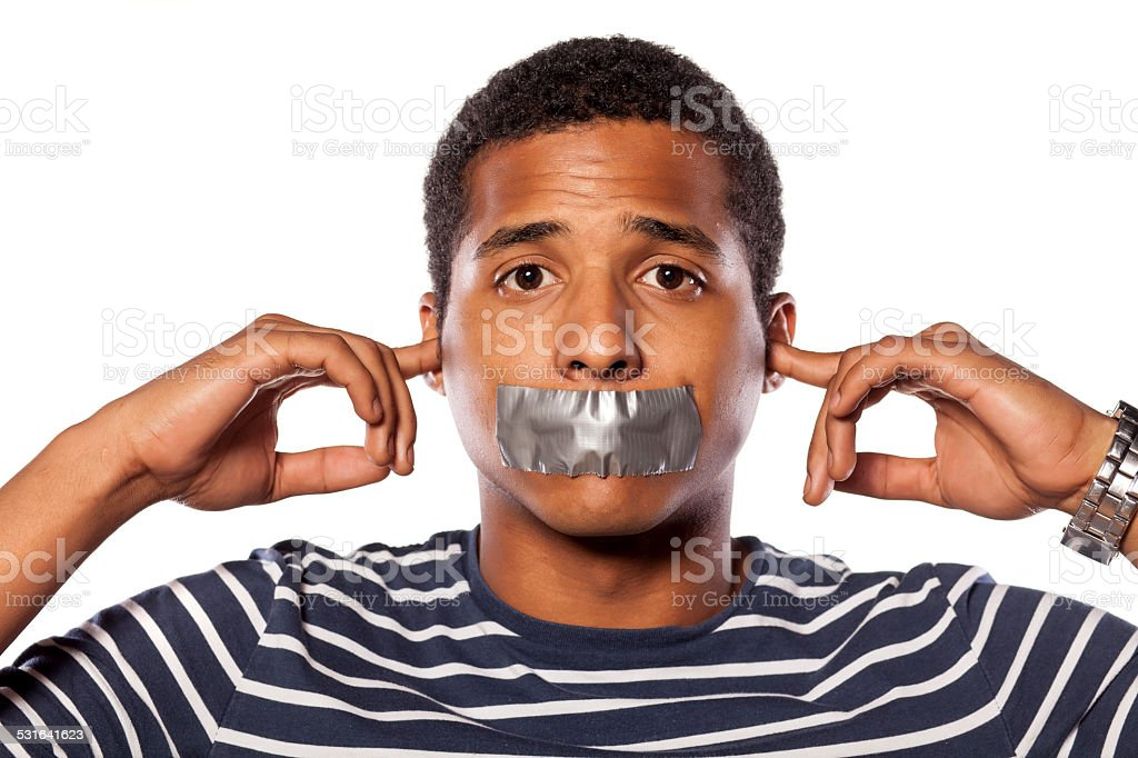 African man with closed ears and adhesive tape over  mouth stock photo