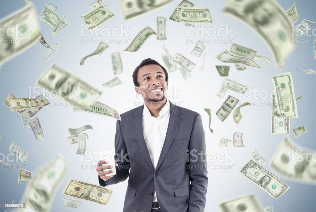 African man with coffee and dollar rain stock photo