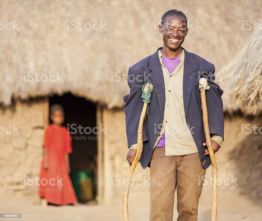 African Man with Crutches stock photo