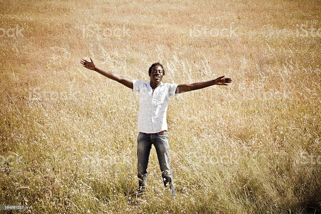 African Man With Outstretched Arms royalty-free stock photo