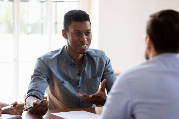 African manager express opinion share thoughts during negotiations with clients stock photo