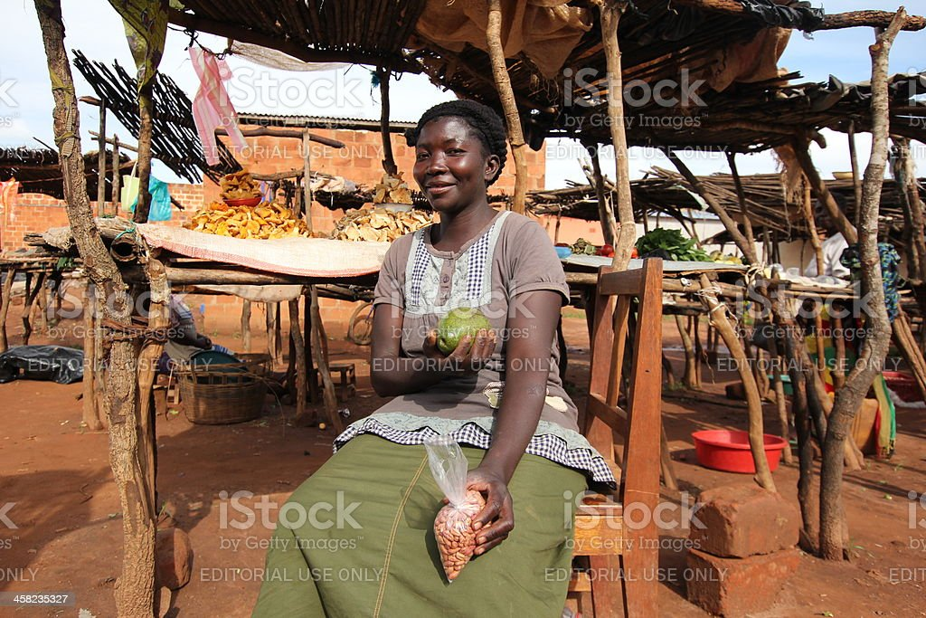 African Market Lady shows her Products. stock photo
