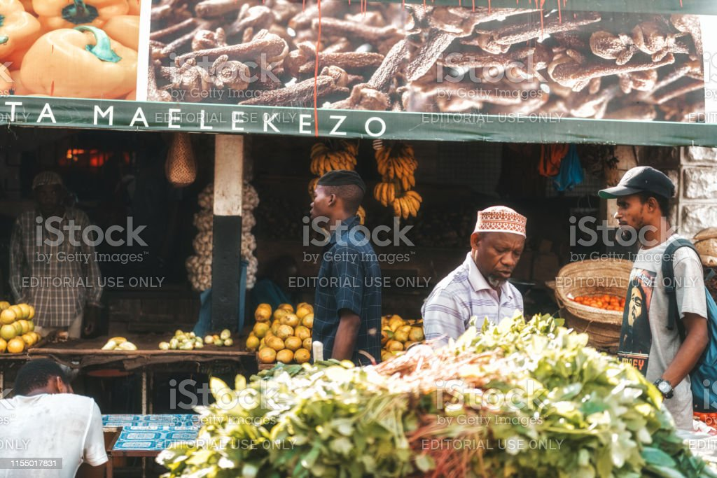 african people on the market place of Stonetown Zanzibar