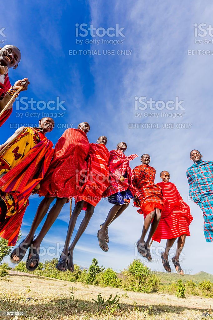 African masai men are dancing and jumping stock photo