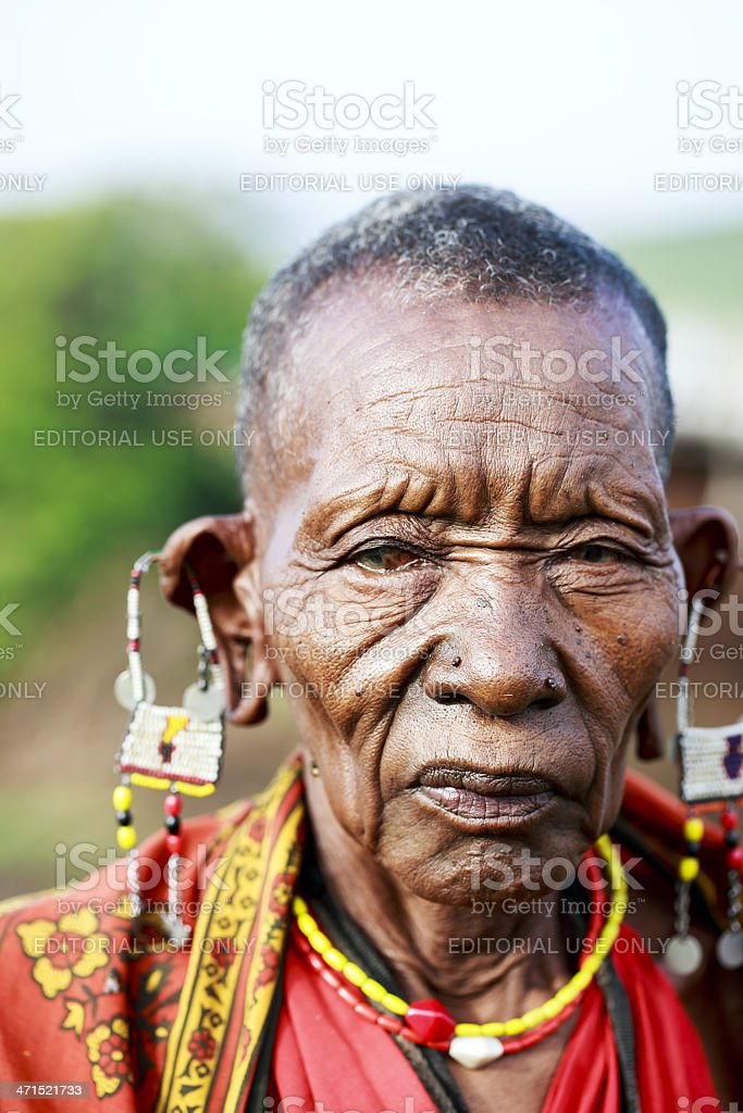 African masai old woman is posing - cataract / open-mouth royalty-free stock photo