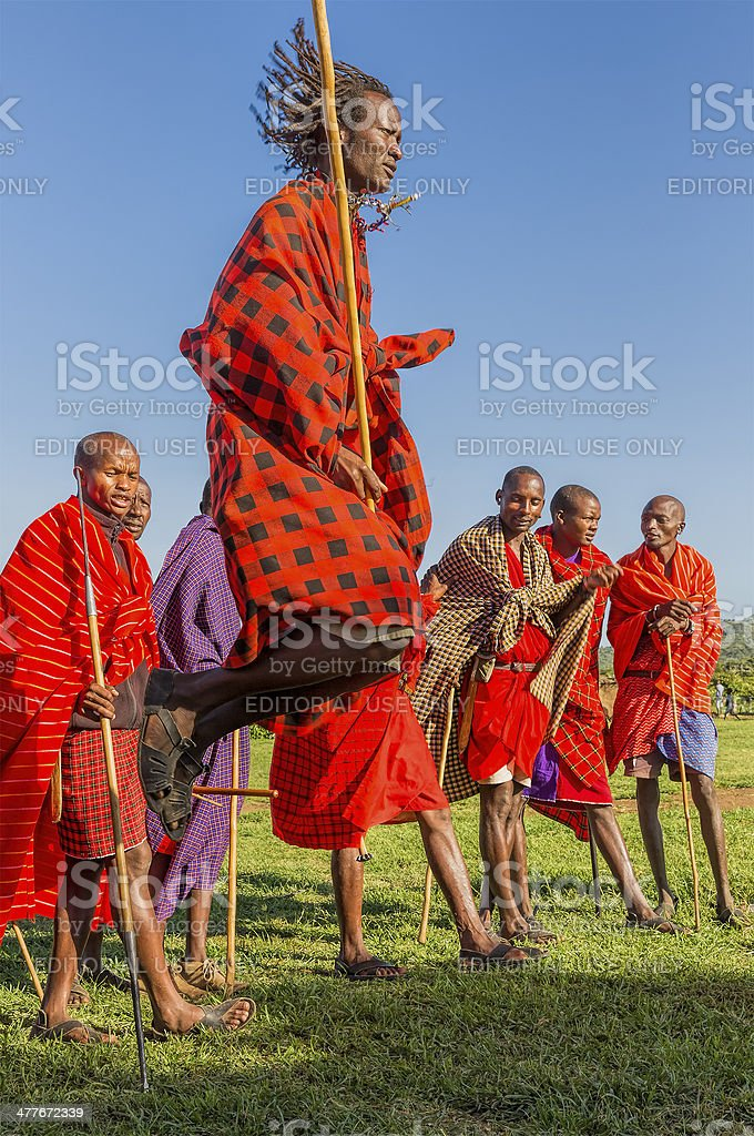 African masai people are posing - dancing stock photo