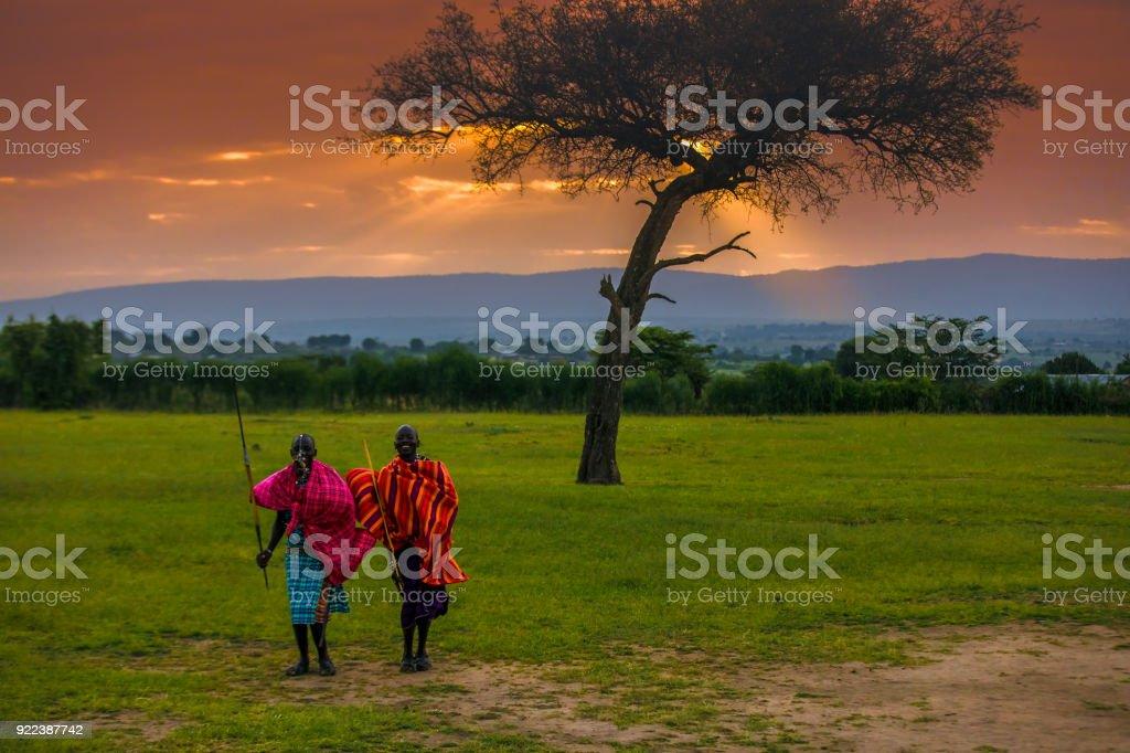 African Masai Warriors at Sunrise stock photo