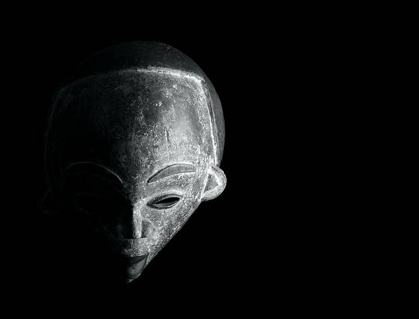 african mask carved stock photo