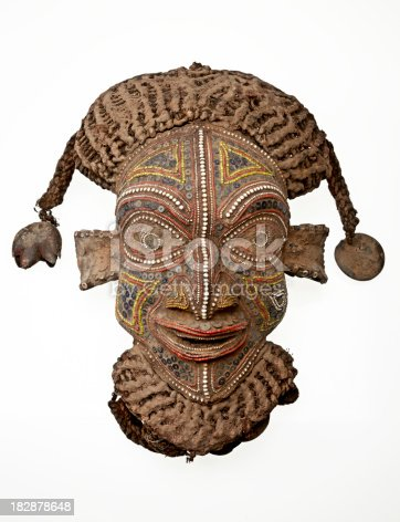 istock African mask isolated on white background 182878648