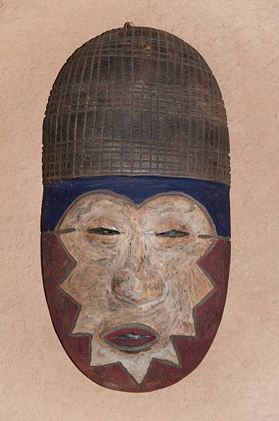 african mask on the wall stock photo