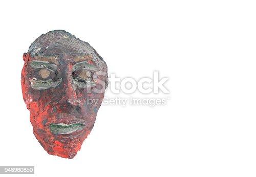 istock African mask on white backround 946960850
