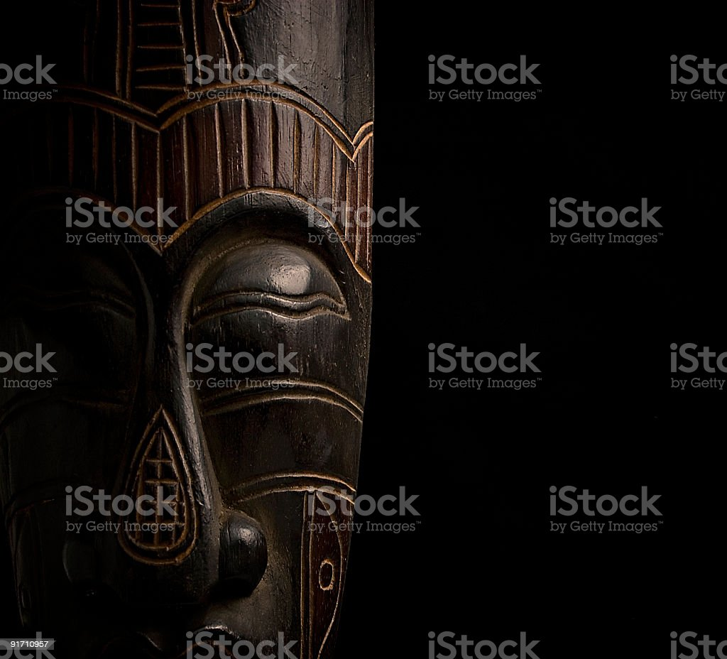African mask over black background stock photo