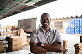 African mature man owner portrait at warehouse