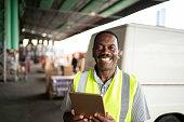 African mature man worker portrait at warehouse
