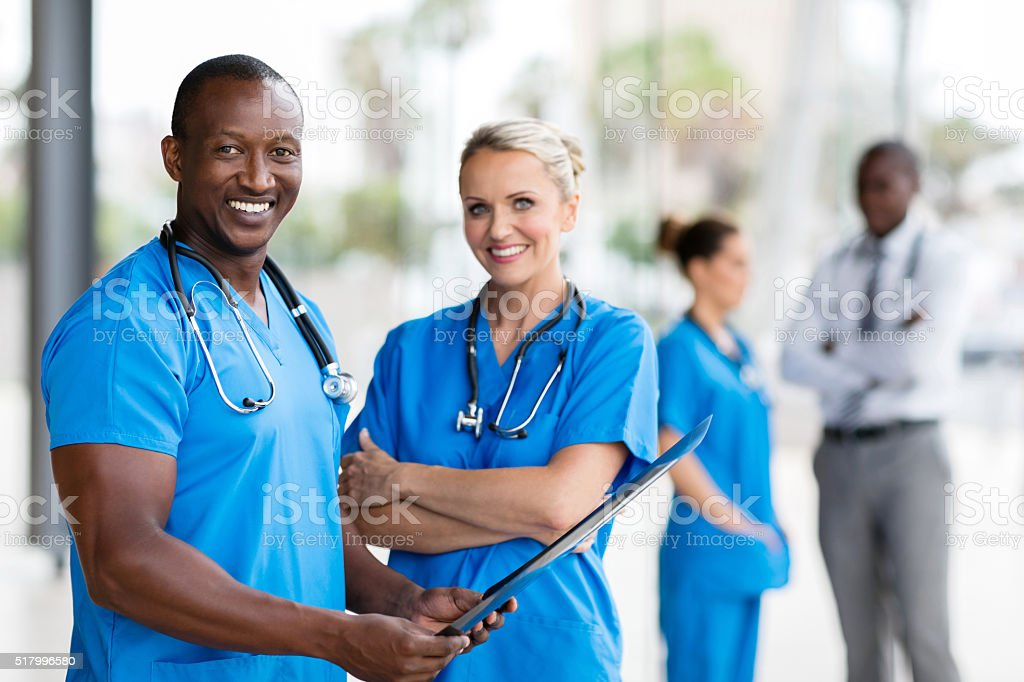 african medical doctor and female nurse stock photo
