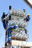 istock African men in overalls working as Electricians on high voltage power lines and equipment at a training facility in South Africa 1160180456