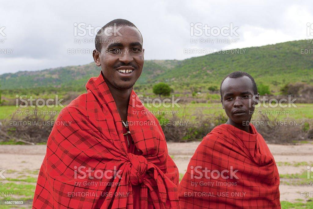 African men pose for a portrait in Masai Mara, Kenya. stock photo