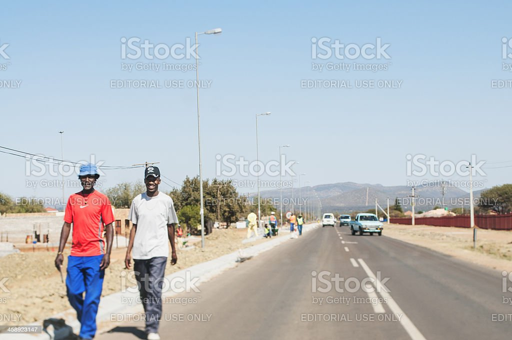 African Men walking down the Road royalty-free stock photo