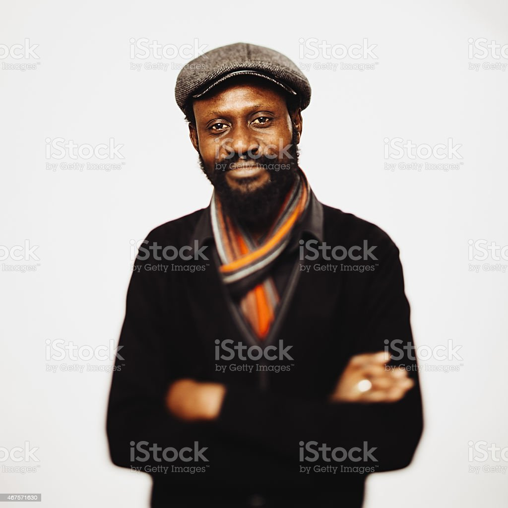 African mid age man portrait with crossed arms. stock photo