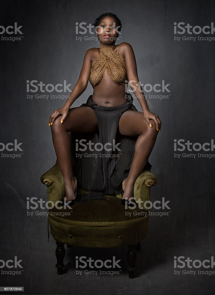 african model sitting with foot on sofa stock photo