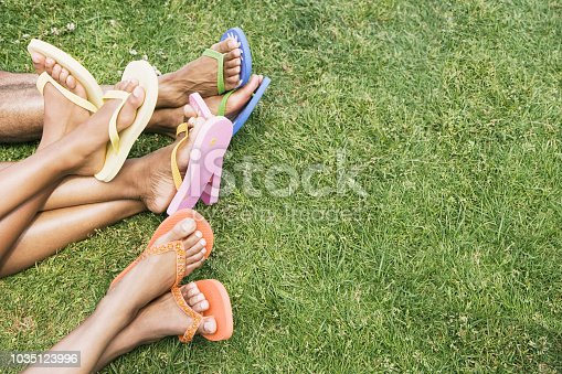African mother and daughters wearing flip-flops