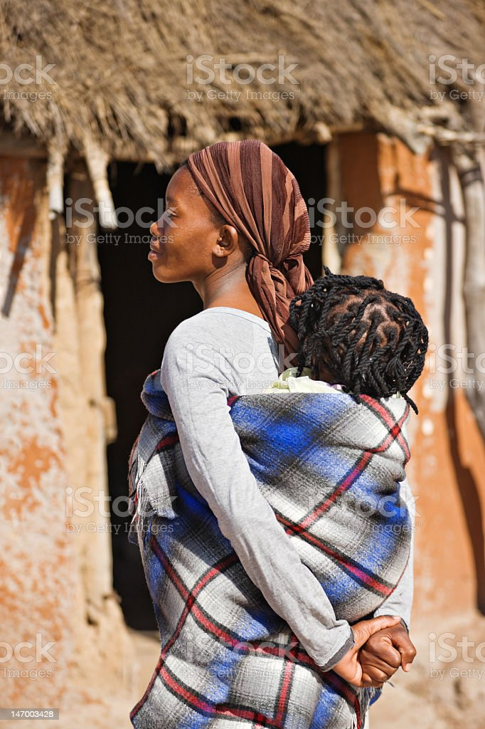 African Mother Carrying Baby In Wrap On Her Back Stock Photo More