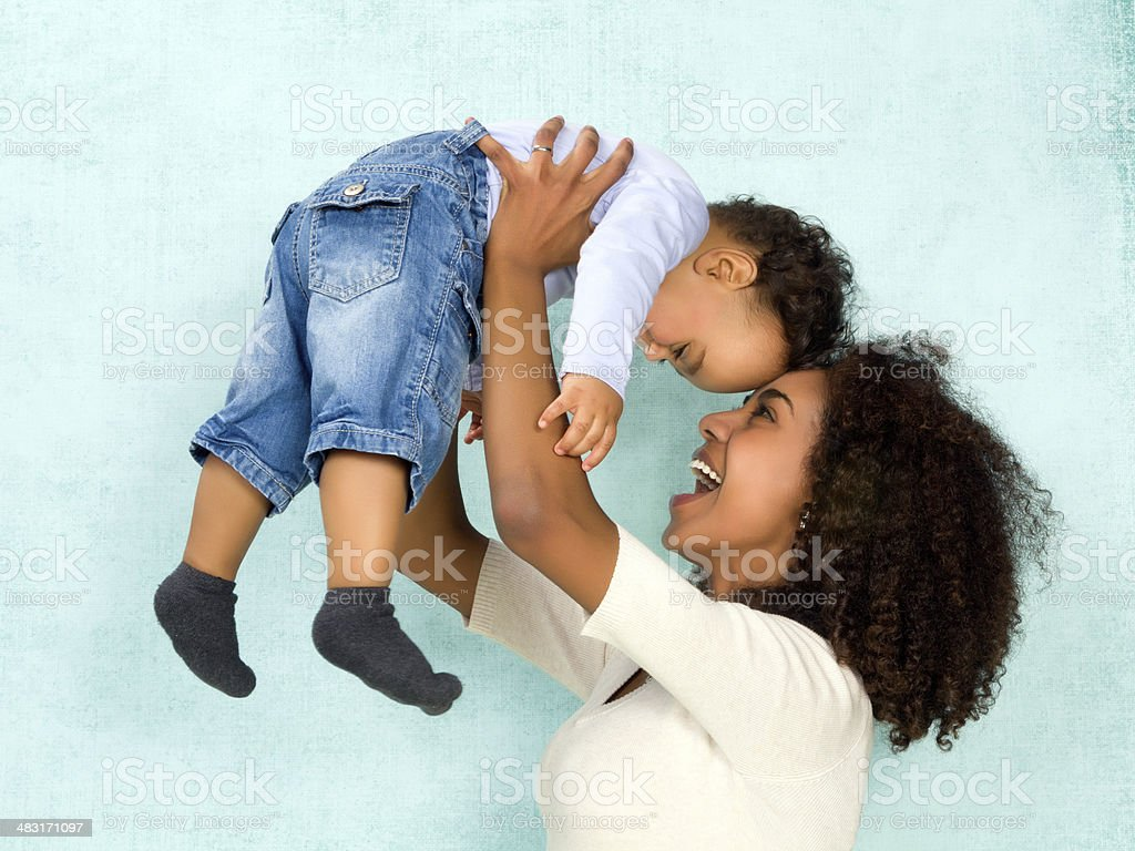 African mother with happy baby stock photo