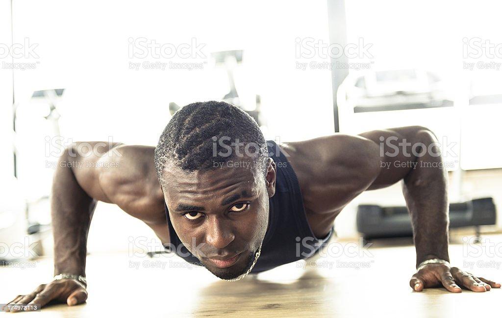 African muscolar man doing pushups royalty-free stock photo