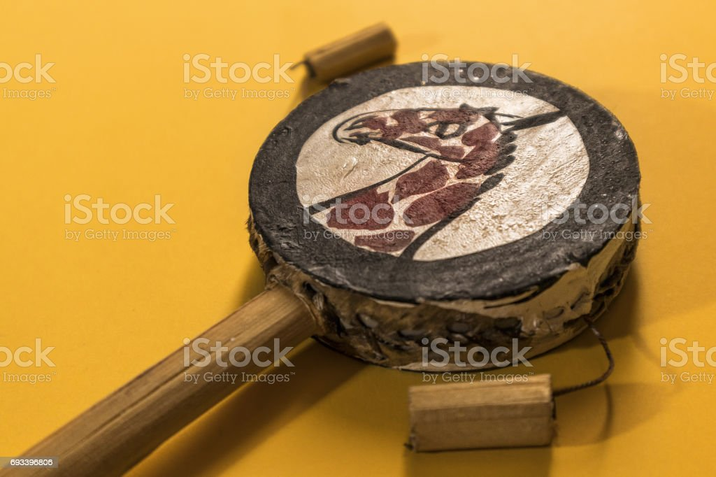 African music instrument isolated on yellow background stock photo