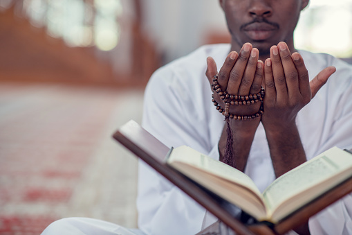 istock African Muslim Man Making Traditional Prayer To God While Wearing Dishdasha 969310388