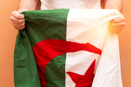 African Nations Cup 2019, closeup man holding algeria flag