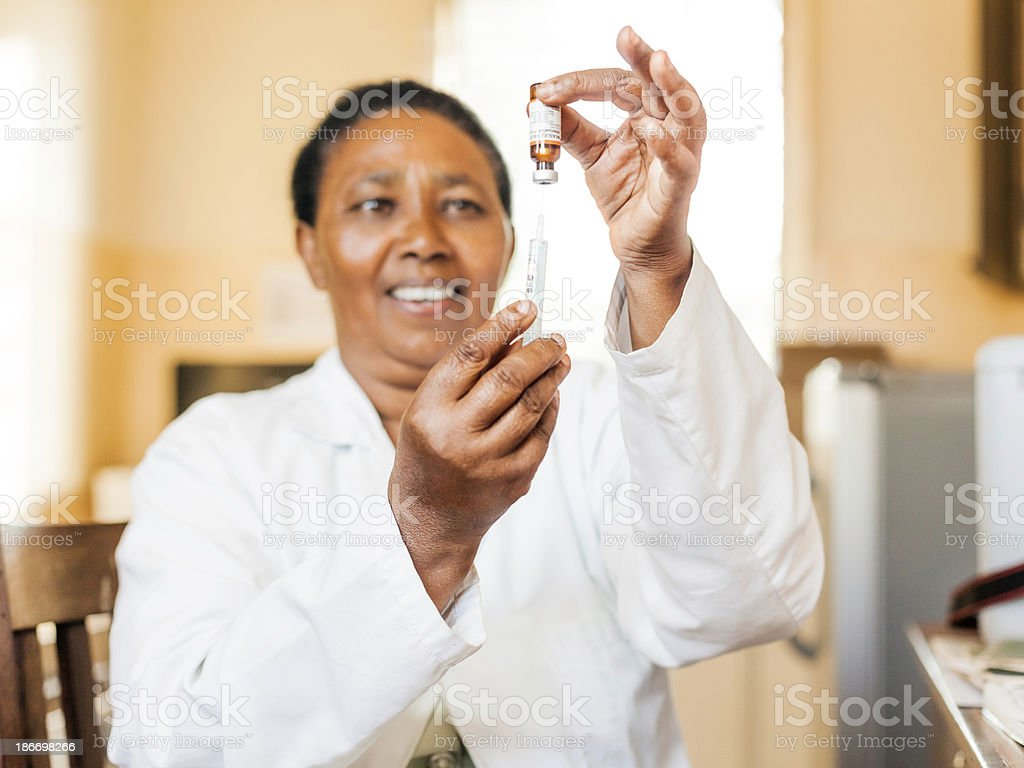 African Nurse and Vaccination royalty-free stock photo