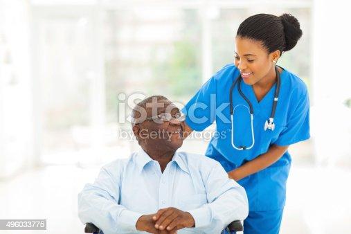 istock african nurse taking care of senior patient in wheelchair 496033775
