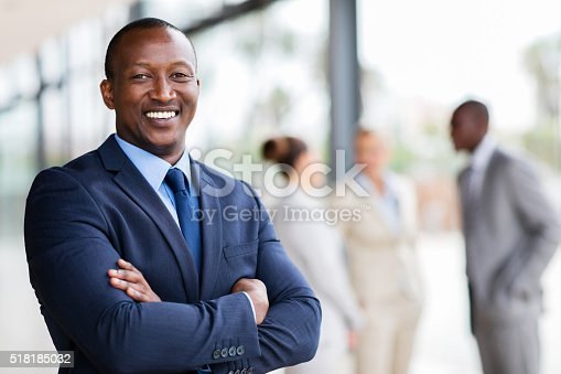 istock african office worker with arms crossed 518185032