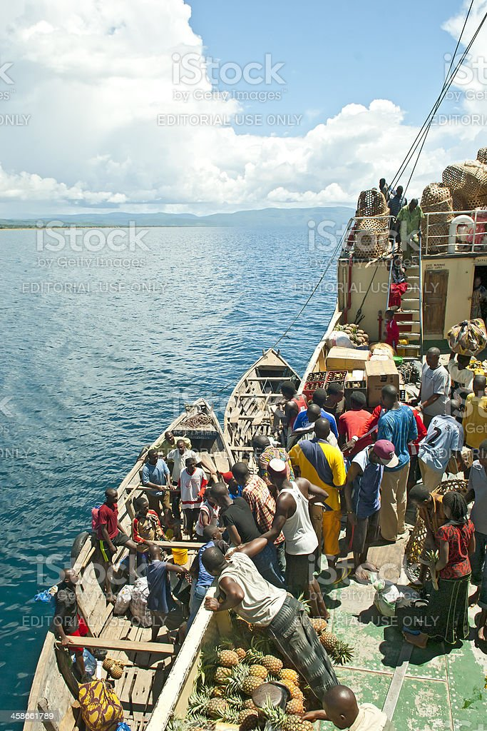 African people are loading goods on board of MV Liemba stock photo