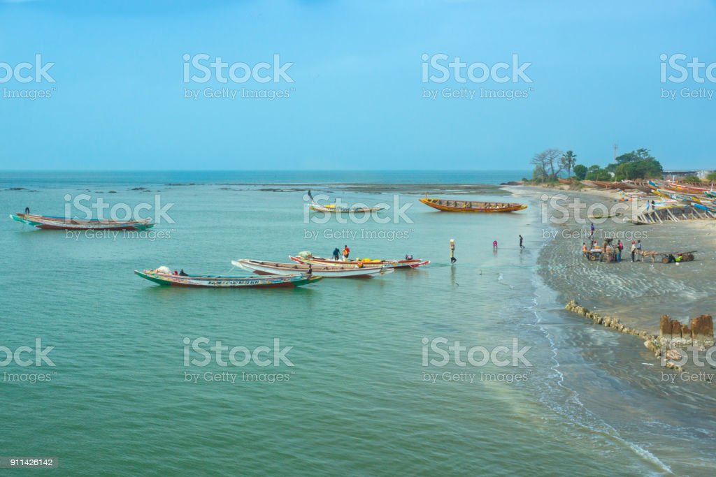 African people on the shoreline of Barra, Gambia stock photo