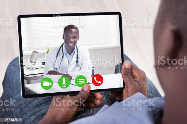African Person Sitting With Digital Tablet Stock Photo - Download Image Now