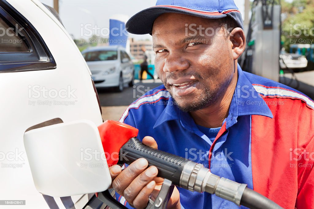 African petrol attendant stock photo