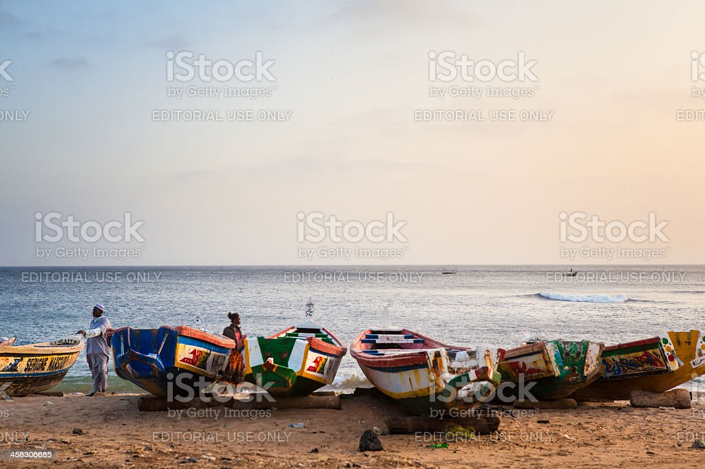 African pirogue canoes on the beach in Dakar stock photo