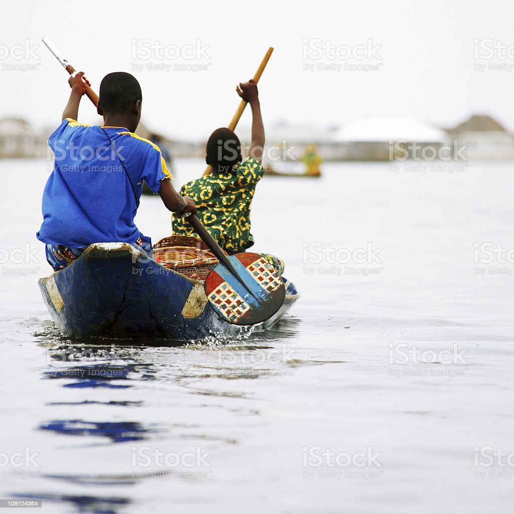 African pirogue ride. stock photo