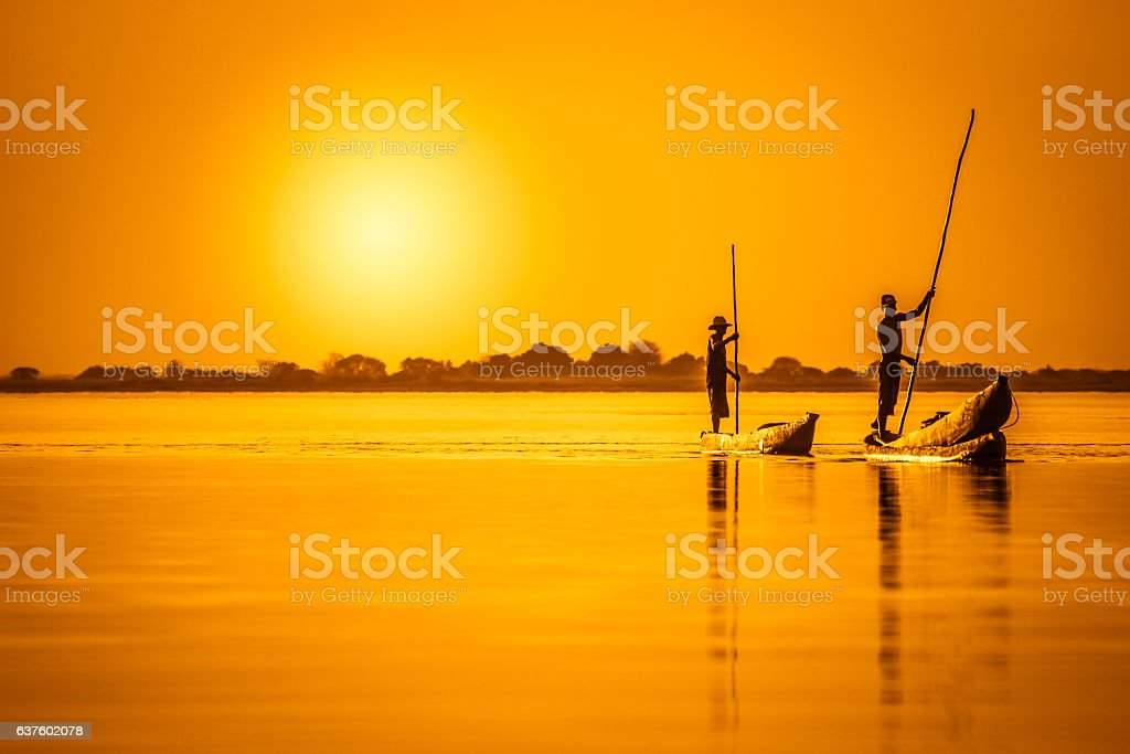 African pirogues at dusk stock photo