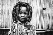 Smiling african rasta boy.\nBenin, West Africa
