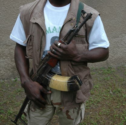 A Muslim Rebel clutches his AK-47 in a country full of unrest.