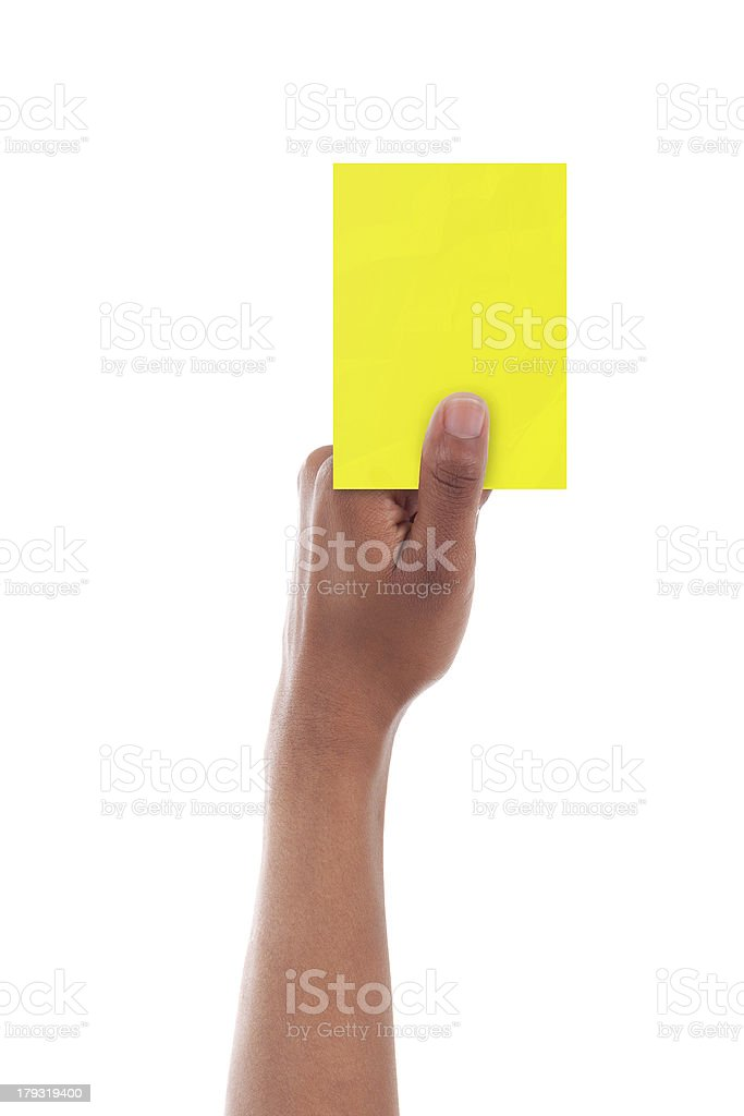 African referee giving a yellow card  - Black people stock photo
