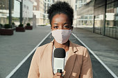 istock African reporter in mask 1271297175