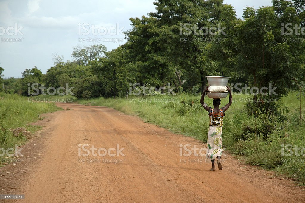 African Road - Woman & Water royalty-free stock photo