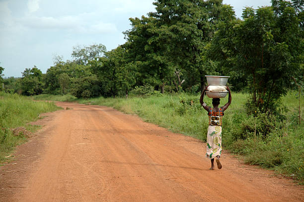 african road - woman & water - carrying stock pictures, royalty-free photos & images