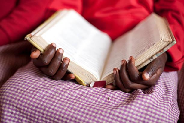 African School Girl reading Bible stock photo